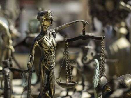 bronze figurine of blind justice with scales