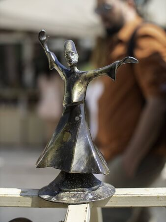 bronze figurine of a whirling dervish at a market