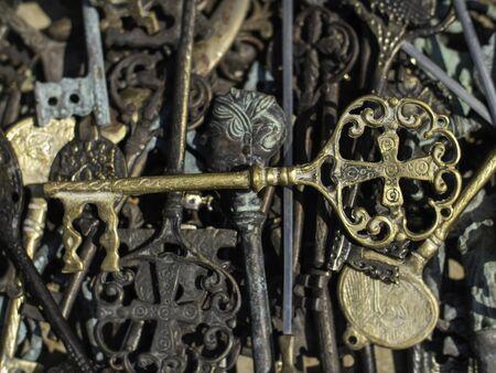 brass key on top ofmany old metal keys