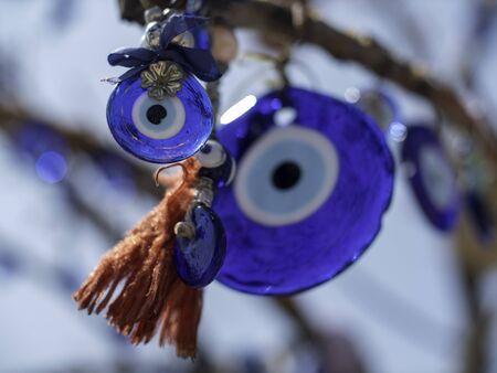 blue glass evil eye trinkets in a tree Stock fotó