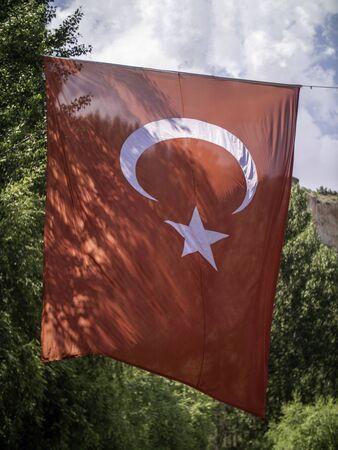 huge Turkish flag flying in forest