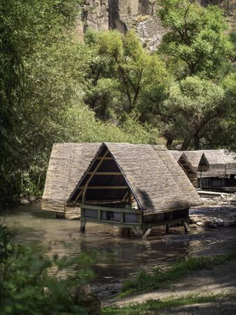 wooden hut structures on a river in Cappadocia Standard-Bild