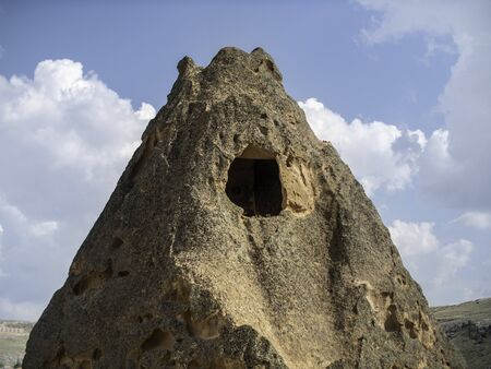cave dwelling in cappadocia dessert Standard-Bild