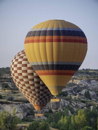 hot air balloon tours rising over cappadocia desert