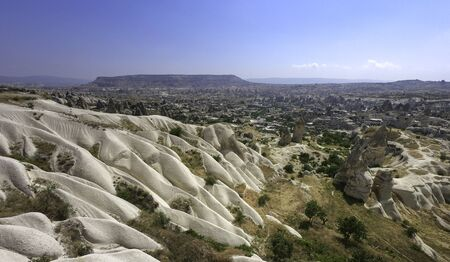 eroded sandstone hills over the town of Goreme