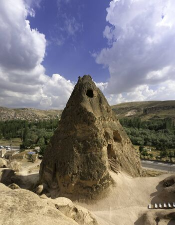 cave house at the top of a sandstone spire in cappadocia desert