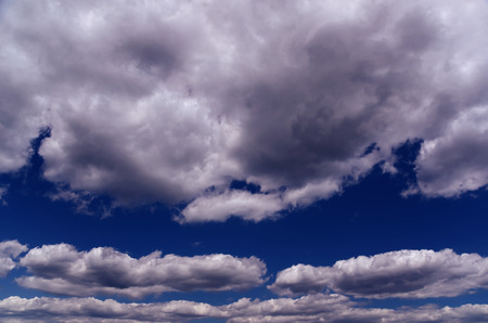 the silvery: Blue Sky with White and Grey Silvery Clouds