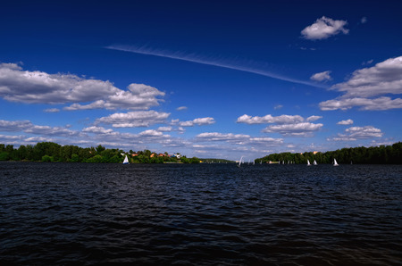 klyazma: Klyazma Water Reservoir in Moscow Region on a Summer Day with Sailboats taking part in a Regatta Stock Photo