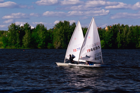 yachtsman: Moscow Russia  June 12 2015  Sailboats taking part in a Regatta in Moscow Region Editorial