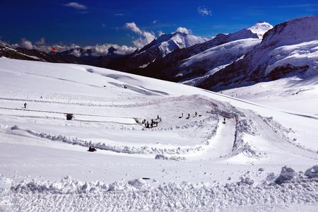 aletsch: Winter Outdoor Entertainments in Swiss Alps. View from Jungfraujoch Top of Europe, Jungfrau Region, Switzerland in the Direction of Aletsch Glacier Photo taken in August Stock Photo