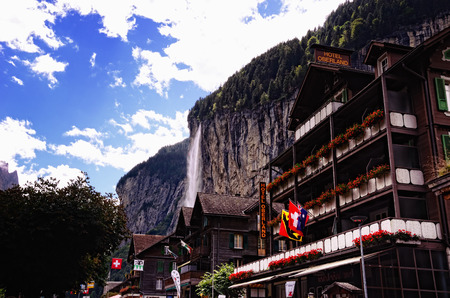 oberland: Lauterbrunnen, Switzerland - August 27, 2014 - Hotel Oberland and Other Buildings with Staubbach Falls in the Background in Tourist Town of Lauterbrunnen in Lauterbrunnen Valley, Jungfrau Region, Switzerland