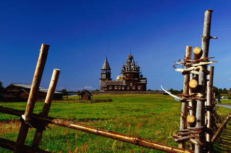 transfiguration: Kizhi Pogost on Kizhi Island, Karelia, Russia. Church of Transfiguration, Church of Intercession, and Bell-tower (UNESCO Cultural Heritage Site) seen from behind the Wooden Fence Stock Photo