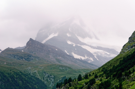 greyish: Matterhorn Mountain (Switzerland) covered with Clouds. View from a Place above Zermatt