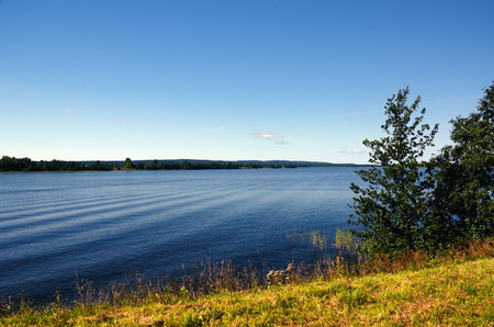 kizhi: Blue Lake and Sky seen from the Grassy Shore on a Fine Summer Day (Photo taken on Kizhi, Russia)