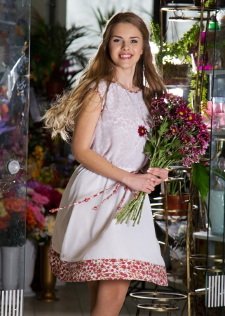 medium length: Girl with flowers Stock Photo
