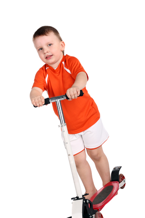 little cute boy with a scooter