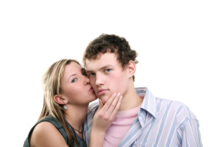 tenderly: young beautiful blonde girl tenderly kissing her boyfriend