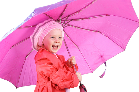 little cute laughing girl under the big pink umbrella