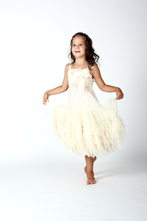 little child dancing in the yellow dress