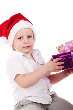 cute little boy in Santa Clauses cap with the gift