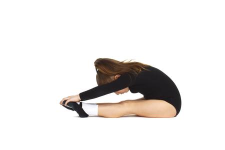 little gymnast girl doing exercise Stock Photo