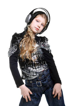 pretty teenage girl listening to the music in headphones and dancing Stock Photo