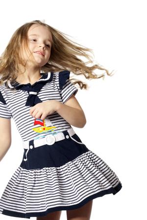 happy little girl dancing in the marine dress