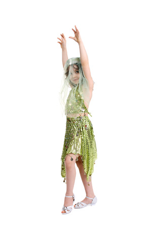 cute little girl dancing in the costume of the eastern beauty