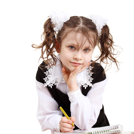 pretty little girl writing in her notebook Stock Photo - 77888836
