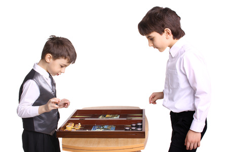two little boys playing backgammon in studio Stock Photo