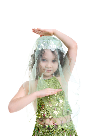 yashmak: pretty little girl posing in the costume of the eastern beauty Stock Photo