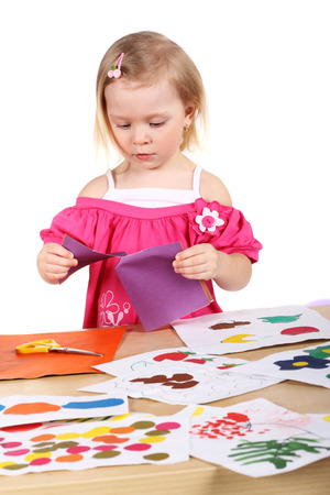 creating: cute little child creating something Stock Photo