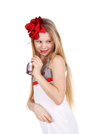 baby facial expressions: charming preteen girl in the white dress and red accessories