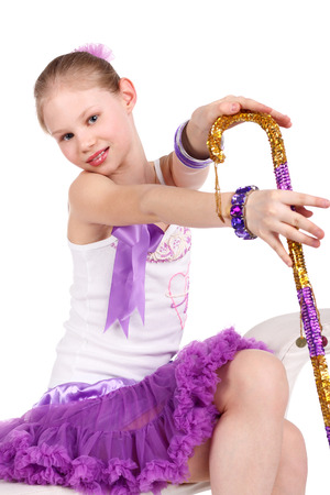 ch: closeup image of a beautiful little girl dancing with the cane