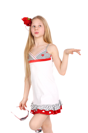 charming preteen girl in the white dress and red accessories