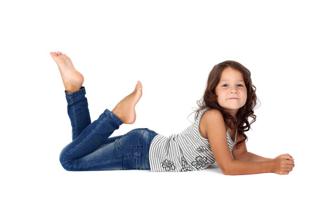little child in jeans lying on the floor