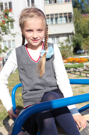 closeup image of the pretty little playing on the playground