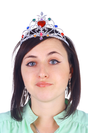 young pretty displeased girl in the diadem