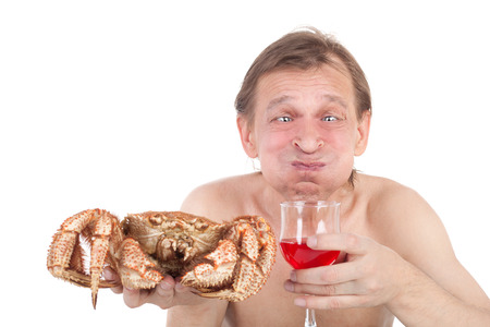 crazy man with a big crab and a glass of wine