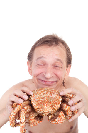 very happy man going to eat a big crab
