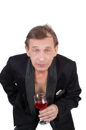 handsome middle aged man with the wine glass in his hand Standard-Bild