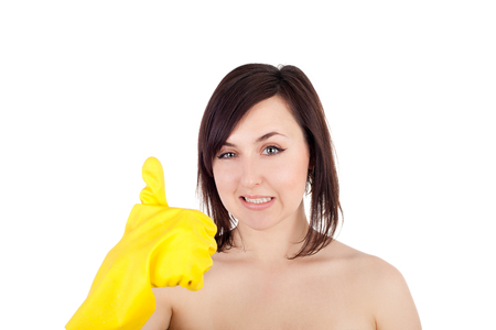 pretty young cleaning woman in the rubber gloves showing ok sign