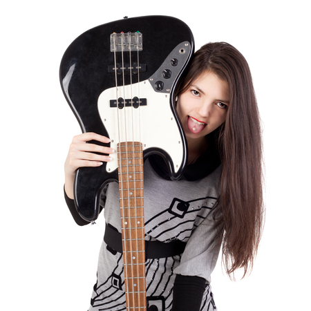 beautiful young brunette girl with the electric guitar
