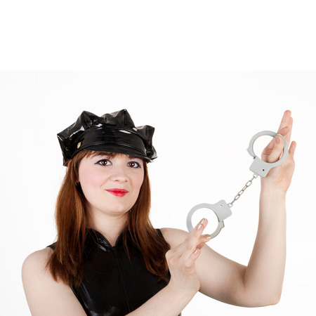sexy police woman showing the handcuffs
