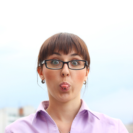cute pretty young girl showing her tongue with piercing Banco de Imagens