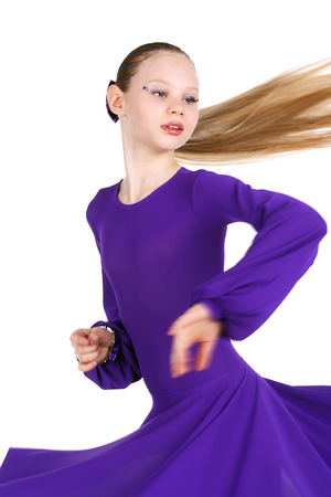 pretty little girl dancing in the violet dress