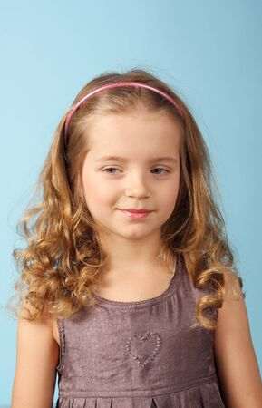 closeup image of the beautiful little girl on the blue background 스톡 콘텐츠