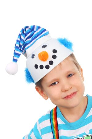 closeup image of the little boy in the snowman cap