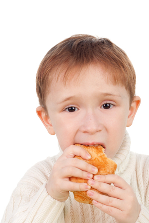closeup image of the handsome little boy eating a snack