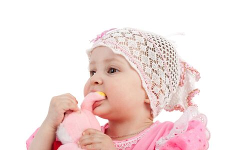 cute sweet little baby girl biting her toy 스톡 콘텐츠
